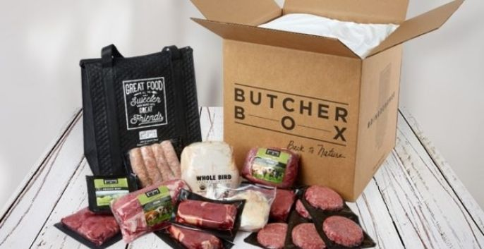 Butcher Box Meat Delivery meats layd out next to a large brown carboard box | The Radiant Root
