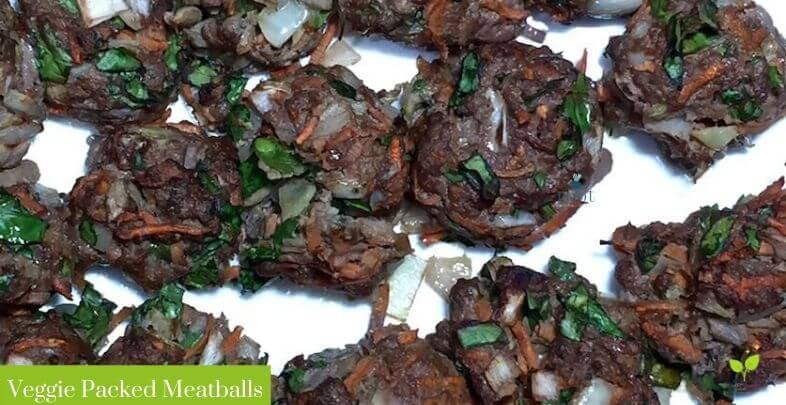 A white plate with healthy meatball recipe featuring ground beef onion, carrots, spinach, garlic, basil and oregano   The Radiant Root