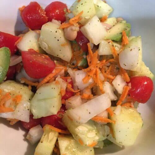 Garlic Cucumber Salad with cherry tomatoes, yellow onions, shredded carrots, avocado, cannellini beans olive oil and wildtree garlic galore   The Radiant Root